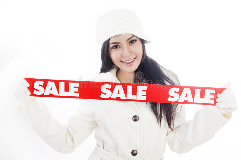 Winter sale 1. Portrait of fashionable woman showing banner of winter sale. isolated on white background royalty free stock image