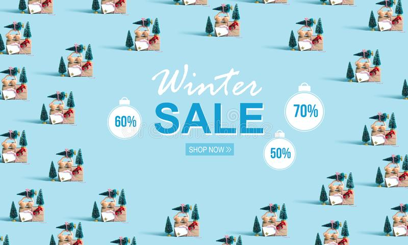 Winter sale message with car carrying Christmas trees. Winter sale message with little car carrying Christmas trees stock photography