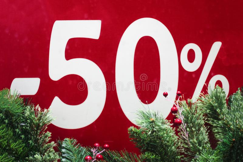 Winter sale 50 percent.Red background with fir branches. 50%  discount. Winter sale. Christmas sale. New year sale royalty free stock photography