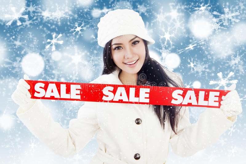 Winter sale with red banner on blue background royalty free stock image