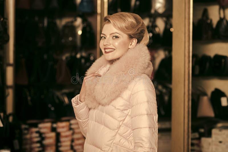 Winter sale. woman in winter coat, shopaholic. royalty free stock photo