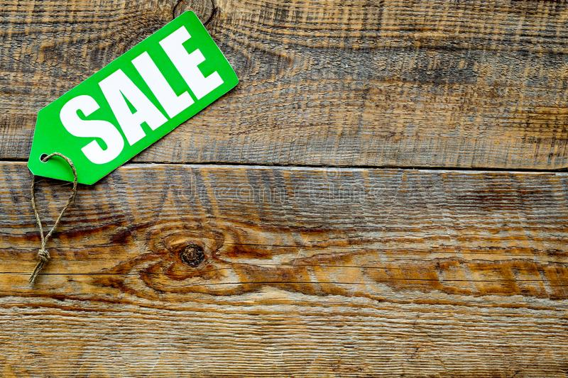 Winter sale. Word sale on green label on wooden background top view copyspace stock photo