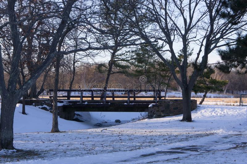 Bridge into Caddy Park, Quincy Mass. Winter scene of the bridge into Caddy Park, located in Quincy, Mass royalty free stock photo
