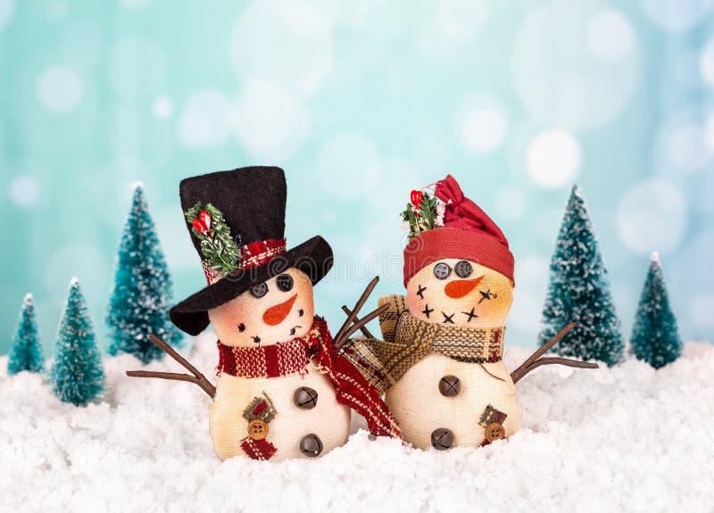 Winter Scene of Christmas Snowmen royalty free stock images