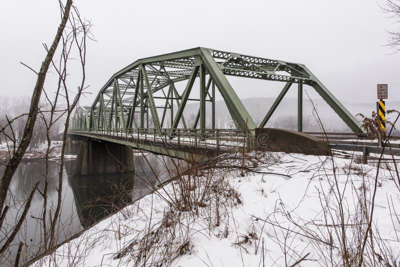 Winter Scene of Historic Truss Bridge over Delaware River. A view of the historic Kellam-Stalker Road Bridge over the Delaware River between Pennsylvania and New stock image