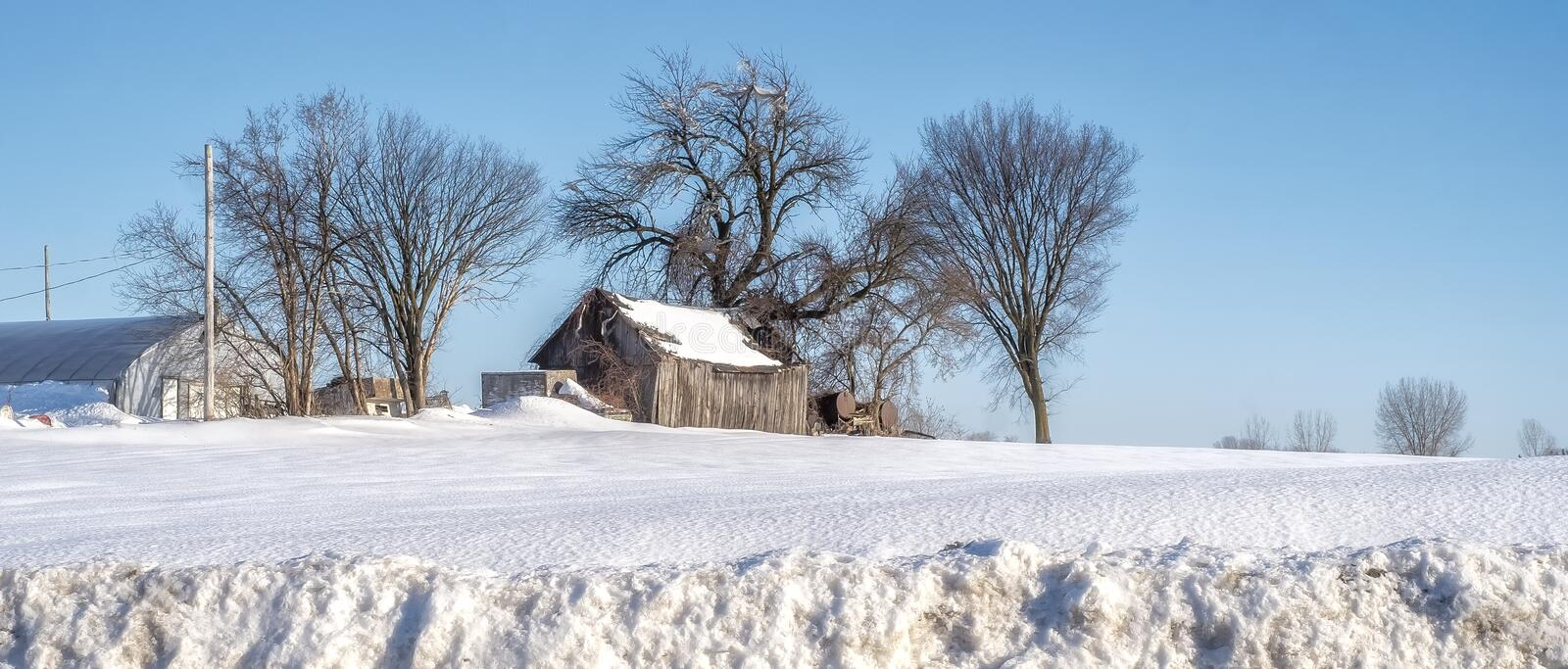 Farm scene on a winter day royalty free stock photography