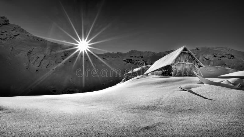 Winter scene in Romania , beautiful landscape of Fagaras mountains, Balea lac. Winter and autumn scene in Romania,mist, white frost over autumn trees , landscape royalty free stock photos