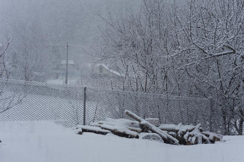 Winter scene in rural landscape. Snowing in the village royalty free stock photos