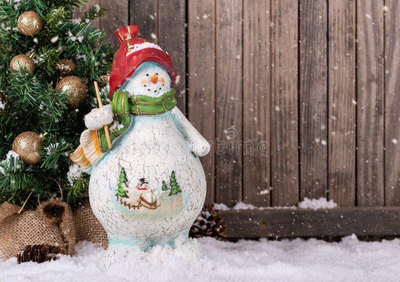 Winter Scene of Snowman and Christmas Tree stock photos
