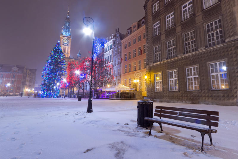 Winter scenery with empty bench in Gdansk stock images