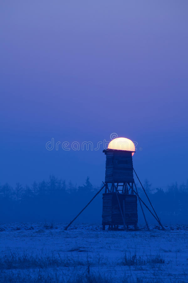 Winter scenery with hunters tower stock photography