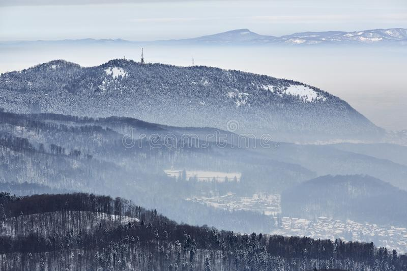 Winter scenery, misty valleys, Tampa mountain, Brasov city, Romania stock image