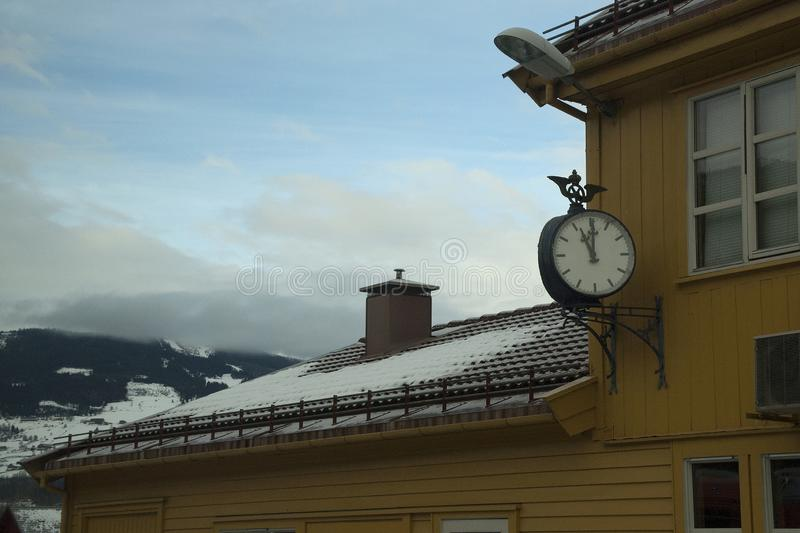 Clock on railway station platform royalty free stock photography