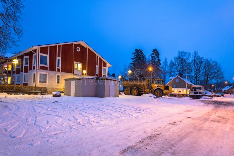 Winter scenery with red wooden house in Sweden at night. Road kyrkhult snow nature lapland street beautiful landscape lamp northern white travel blekinge stock photo
