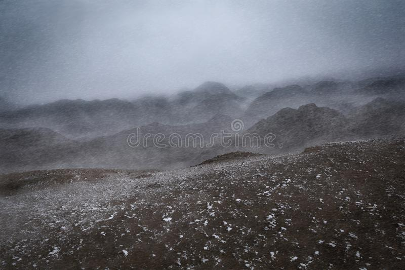 Winter, scenery of snowstorm hits the mountain range. royalty free stock images