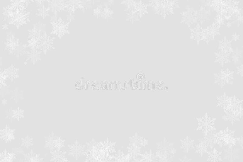 Winter-Schneeflocken auf einem Silber lizenzfreie stockbilder