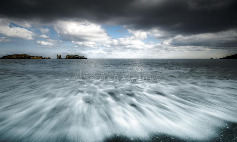 Winter seascape with waves and clouds. royalty free stock photography
