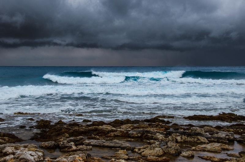 Winter seascape with waves and clouds. stock image
