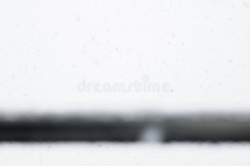 Winter season background with falling snowflakes stock image