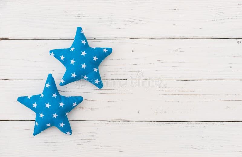 Winter season christmas background, blue stars on white wood stock photo