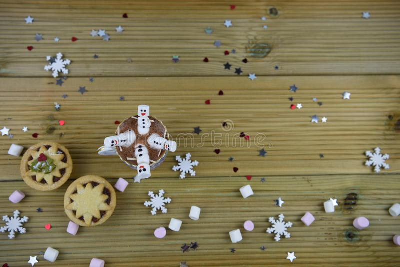 Christmas photography food and drink image with hot chocolate cup and mini marshmallows shaped as happy snowman stock images