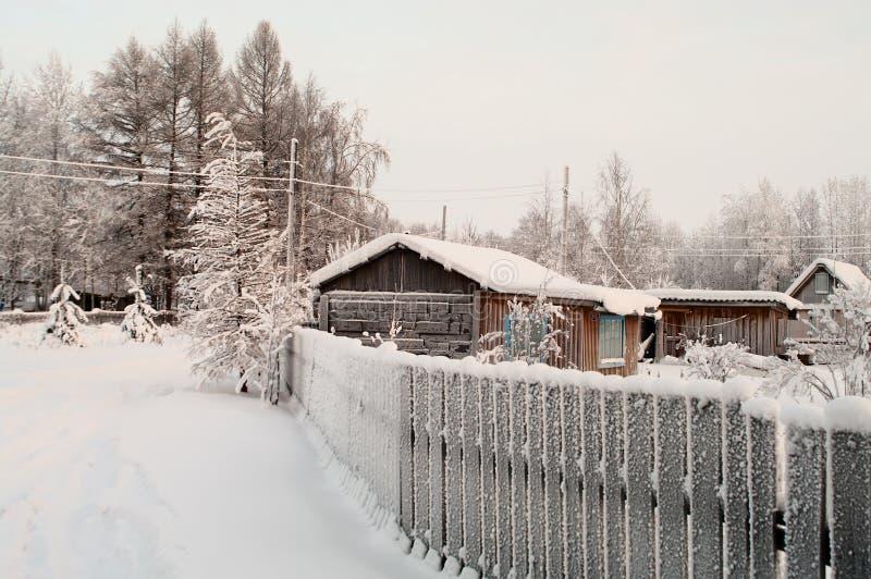 Winter season in Russian village royalty free stock image