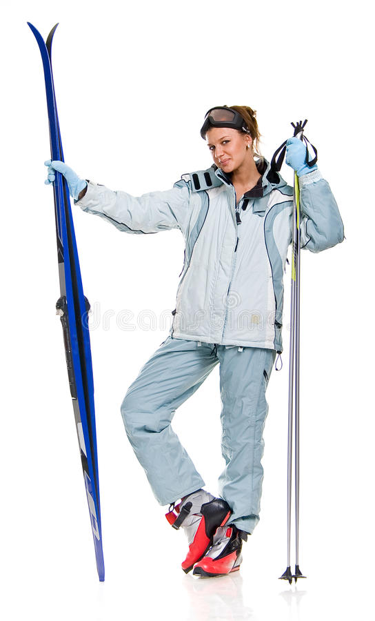Winter girl in grey sports suit and with skis stock photos