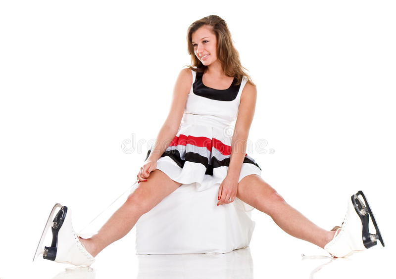 Winter sexy girl in skates and white dress