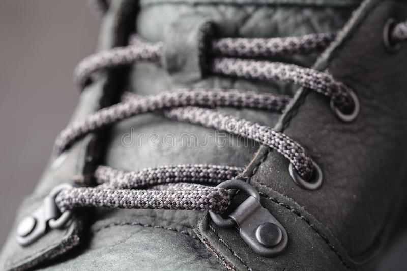 Winter shoes close up view on wooden floor royalty free stock photography