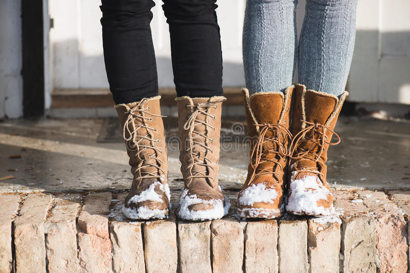 Winter shoes. Snow boots in cold weather stock photography