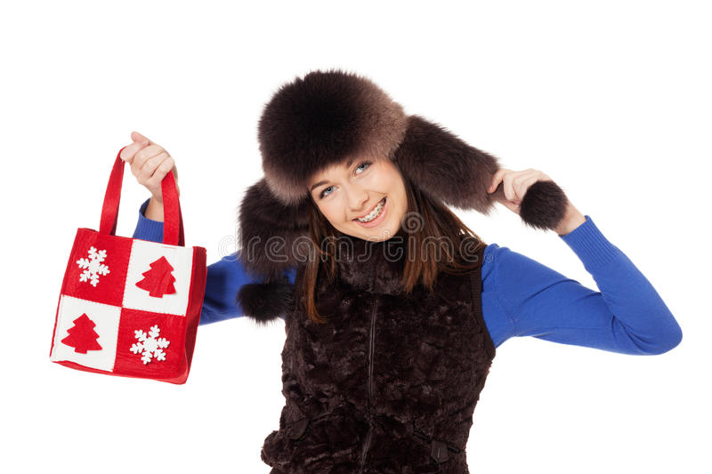 Winter shopping. Smiling teenage girl with braces after winter shopping stock image