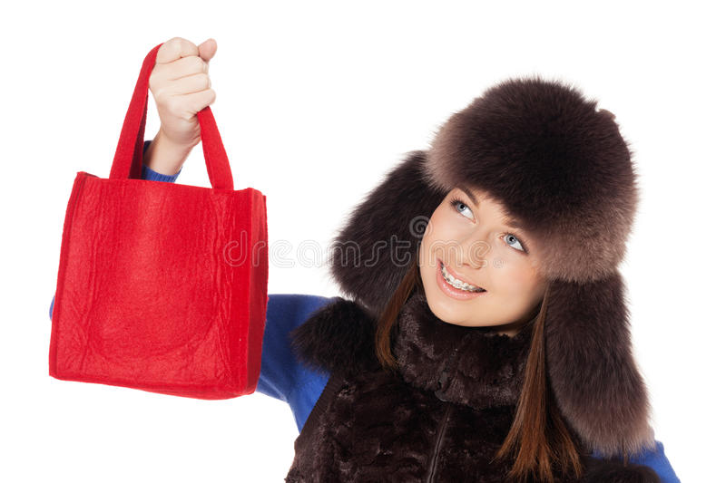 Winter shopping. Smiling teenage girl with braces after winter shopping stock images