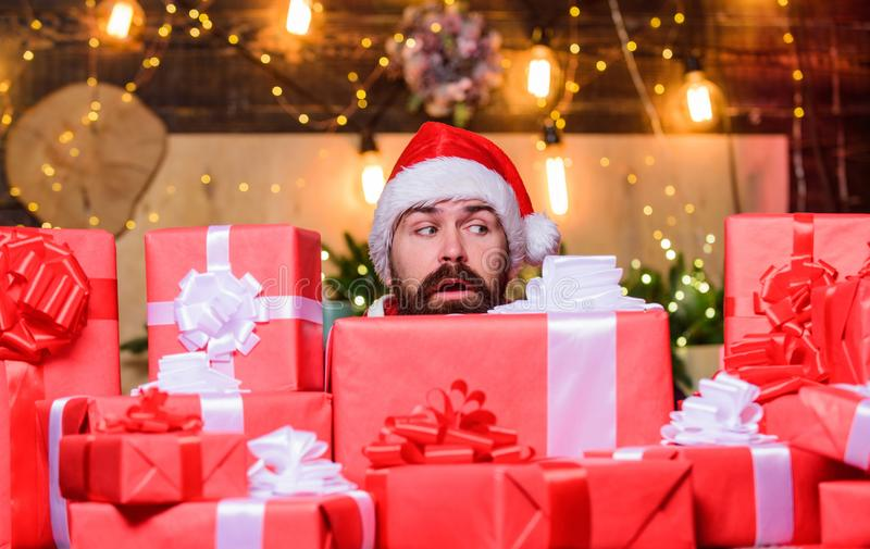 Winter shopping sales. Cheerful elf. sad bearded man. happy new year. Xmas present box. christmas gift delivery. Boxing royalty free stock photography