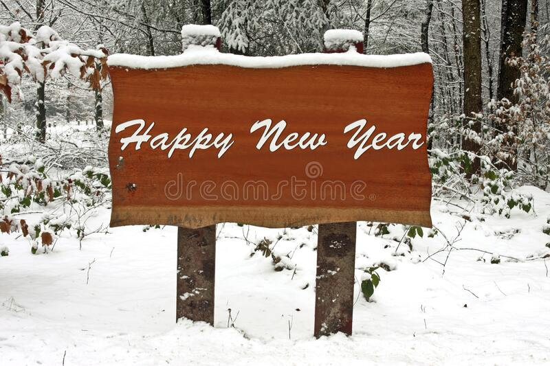 Snowy sign with Happy New Year stock photos