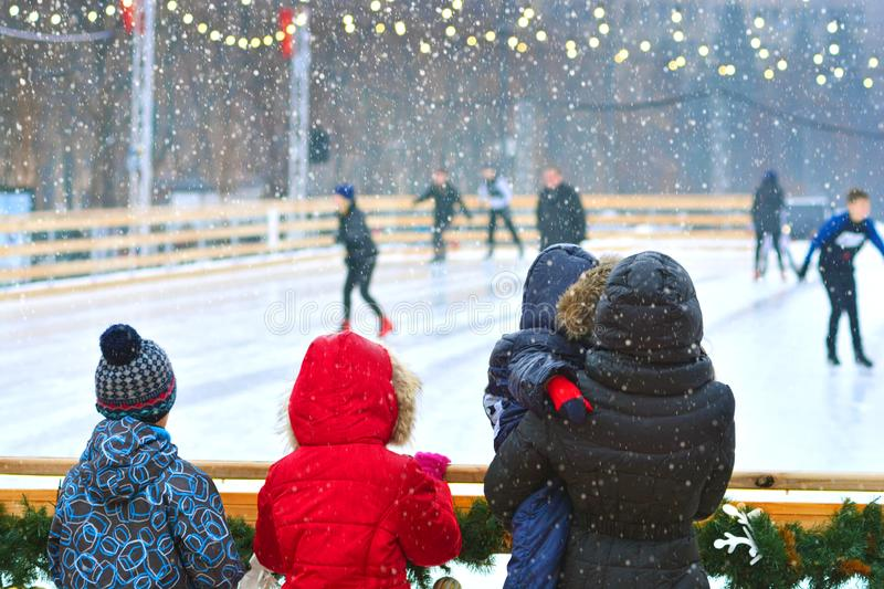 Winter. Skating rink. People in front of rink royalty free stock image