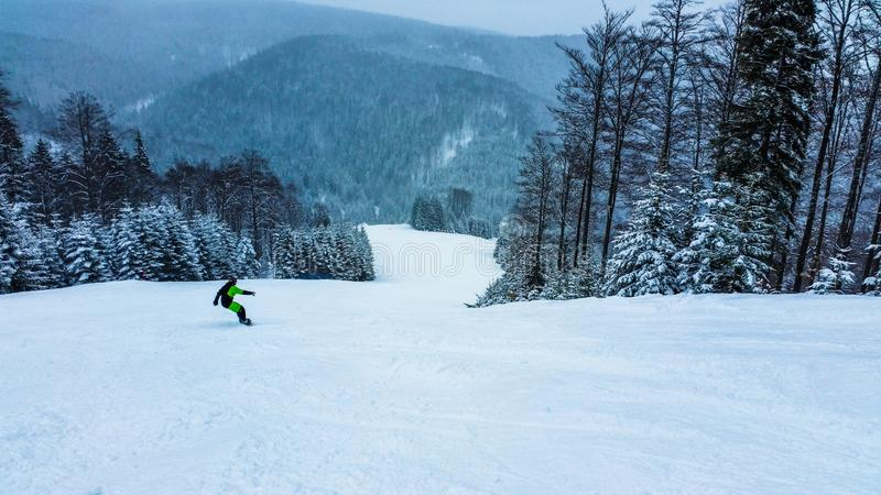 Snowboarder in the mountains. Winter. Ski slope. Sport activities stock photography