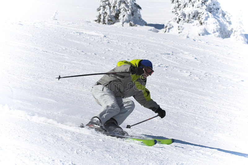 Winter ski sports. Skier downhill royalty free stock images