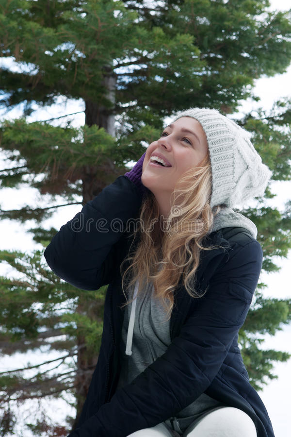 Winter smile. Portrait of young beautiful woman on winter outdoor background royalty free stock photo
