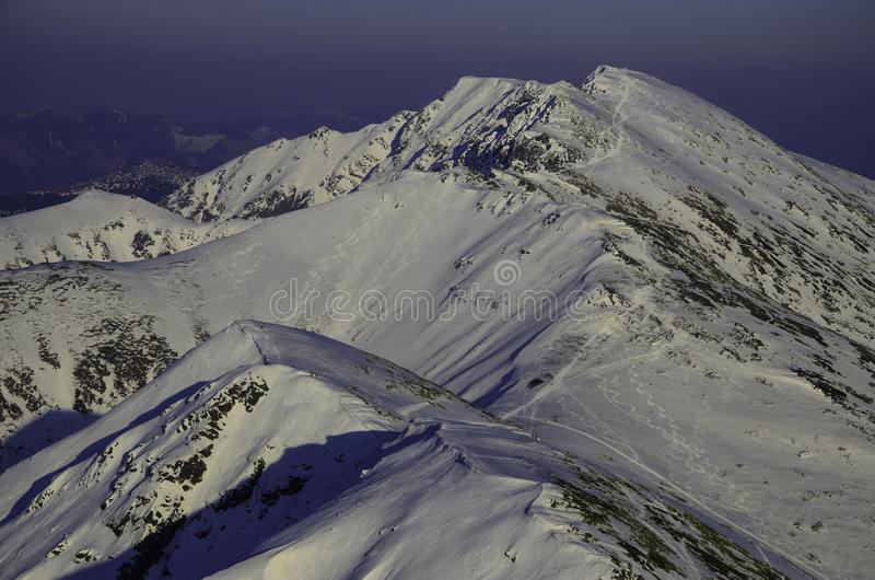 Winter snow covered mountain peaks in Europe. Great place for winter sports royalty free stock image