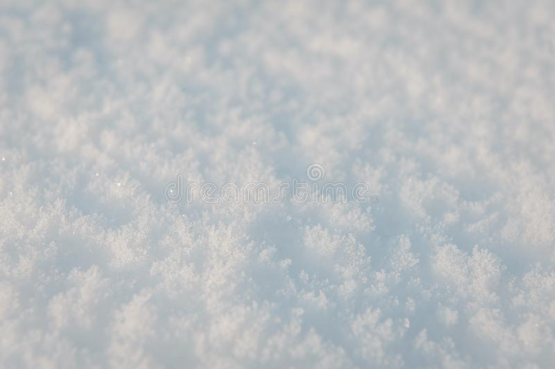 Winter snow. Fresh snow background texture. Snowy white texture. Snowflakes. royalty free stock images