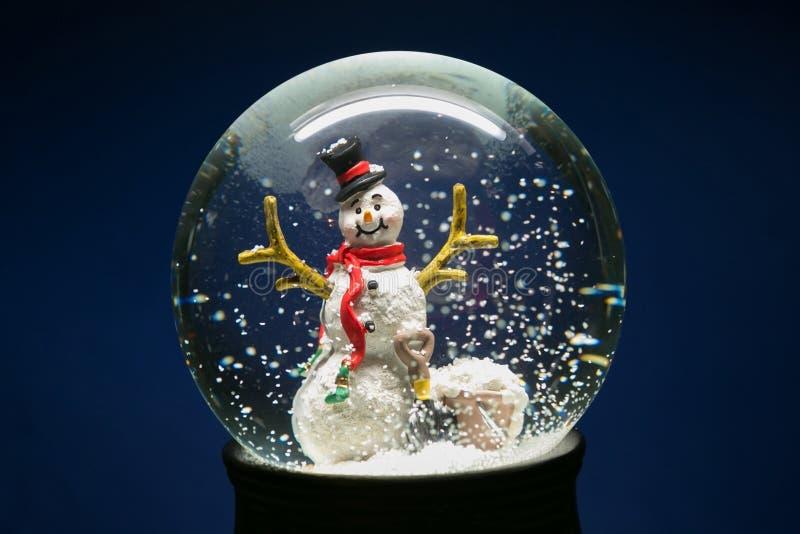 Winter Snow Globe With Snowman on Blue stock photos