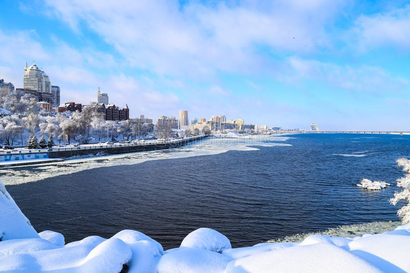 Winter snow landscape of the Dnipro city. View of the buildings, skyscrapers, Dnieper river. towers, Ukraine, Dnepropetrovsk royalty free stock images