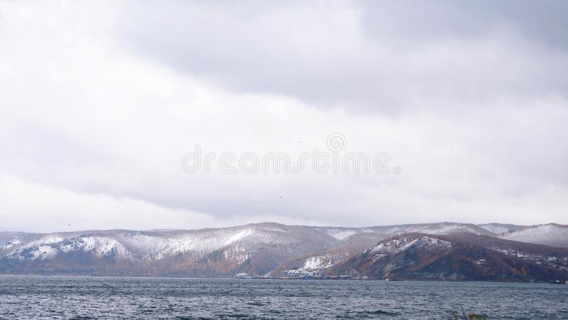 Winter snow mountain baikal lake landscape view in Listvyanka Russia.  royalty free stock images