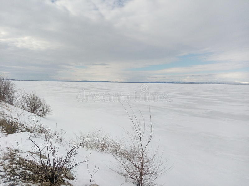 Winter, snow, overcast,River under the ice, ice fishing, sky clouds, white horizon,white steppe royalty free stock images