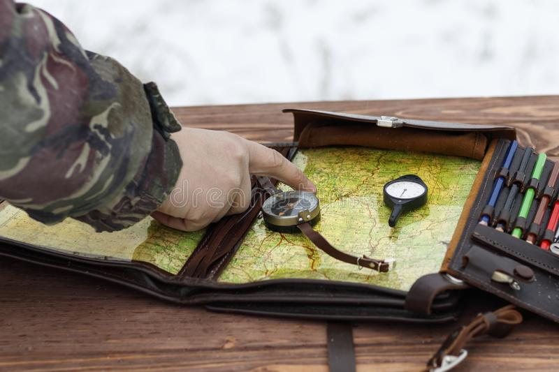 . Winter is snowing. Combat training. determine the military route on the map. there is toning stock photo
