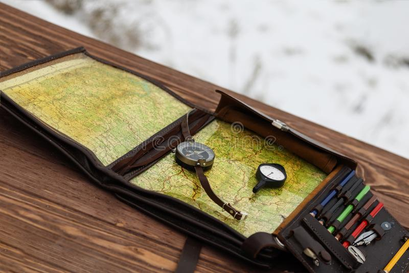 . Winter is snowing. wooden table. There is a compass and odometer. there is toning. Winter is snowing. wooden table. There is a compass and odometer. there is royalty free stock photos