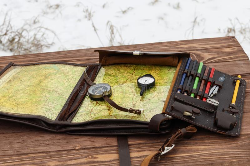 . Winter is snowing. wooden table. There is a compass and odometer. there is toning. Winter is snowing. wooden table. There is a compass and odometer. there is stock photos