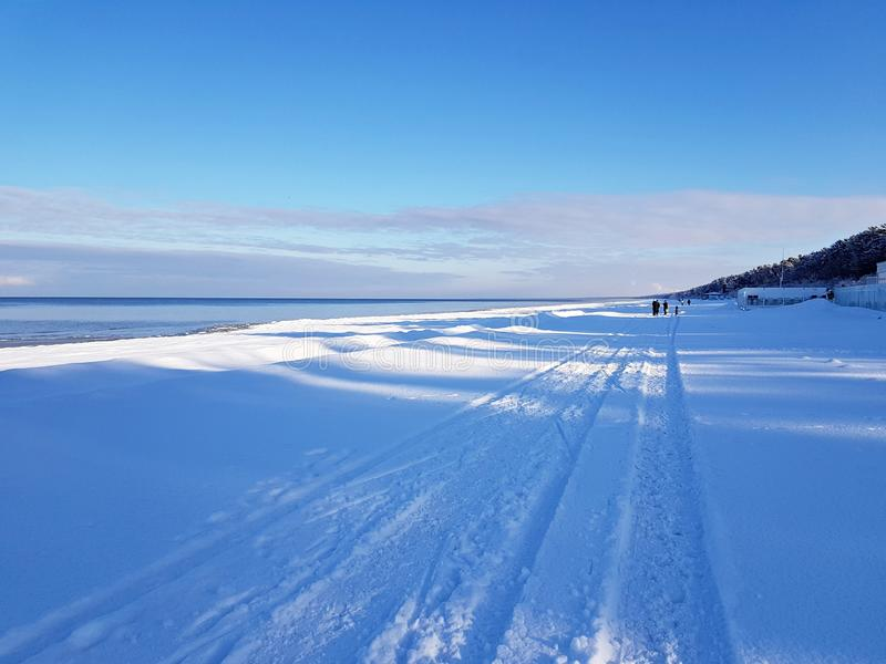 Winter snowy coast of the sea coast on a quiet sunny day.  royalty free stock images