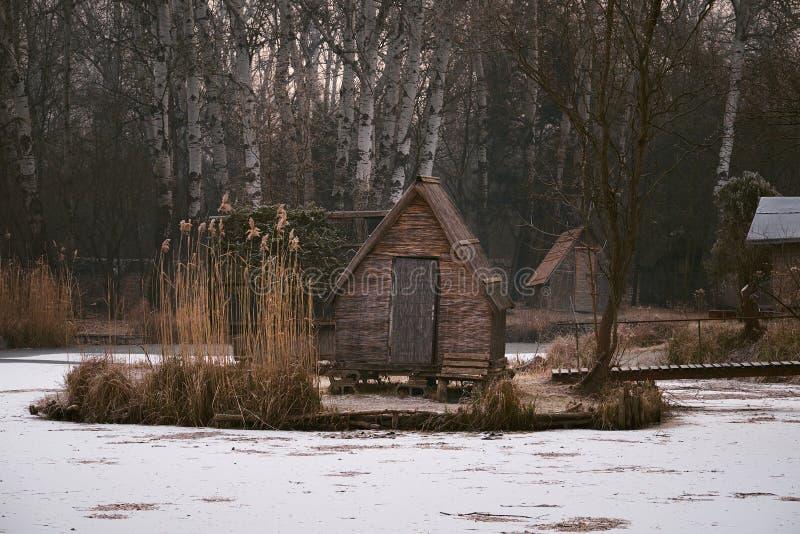 Winter snowy lake. Fishing huts on winter lake royalty free stock photos