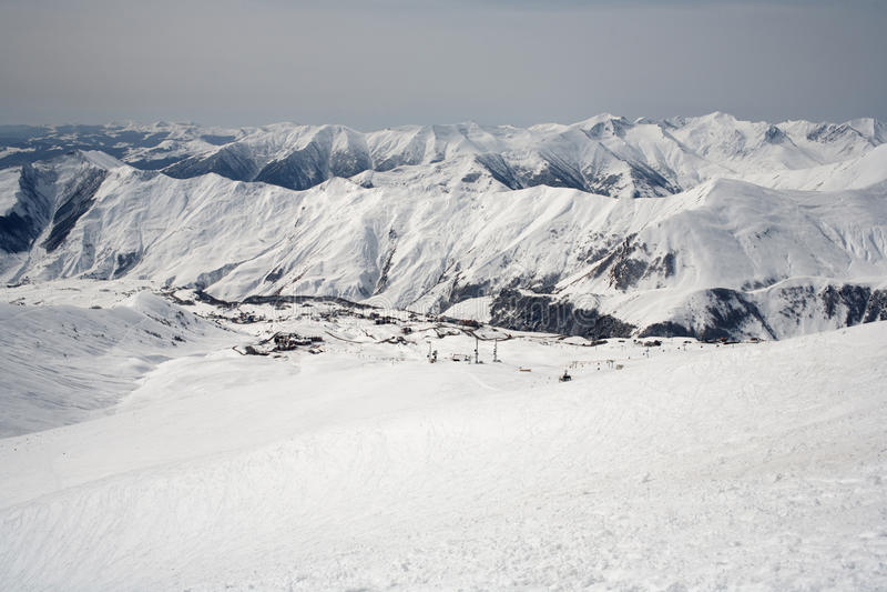 Winter snowy mountains and blue sky. Caucasus Mountains, Georgia, ski resort Gudauri.  stock photography